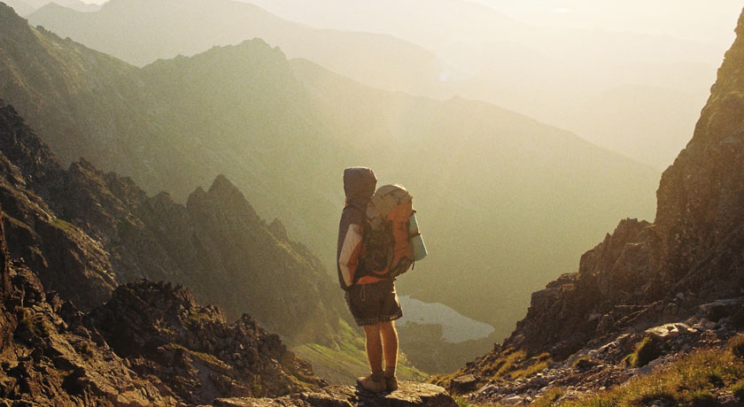 Person hiking in a valley - pic by Danka Peter