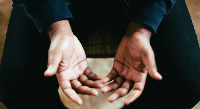 Man with hands opened in prayer