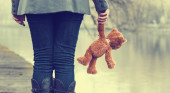 Lonely woman with teddy bear
