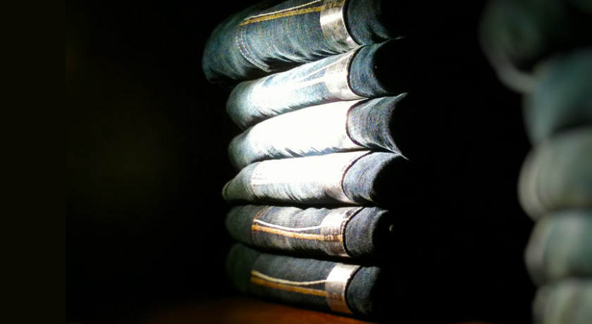 Stack of jeans in store