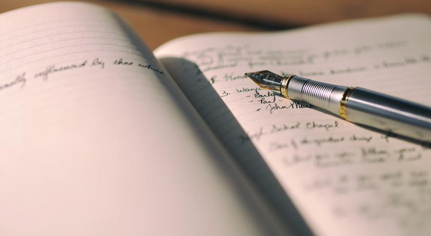 Fountain pen writing in a journal