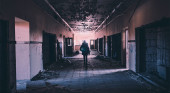 Woman walking through derelict building
