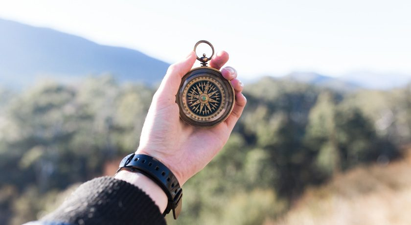 Woman's hand holding a compass - pic by Heidi Sandstrom