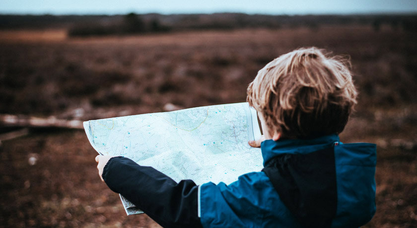 Boy checking a map