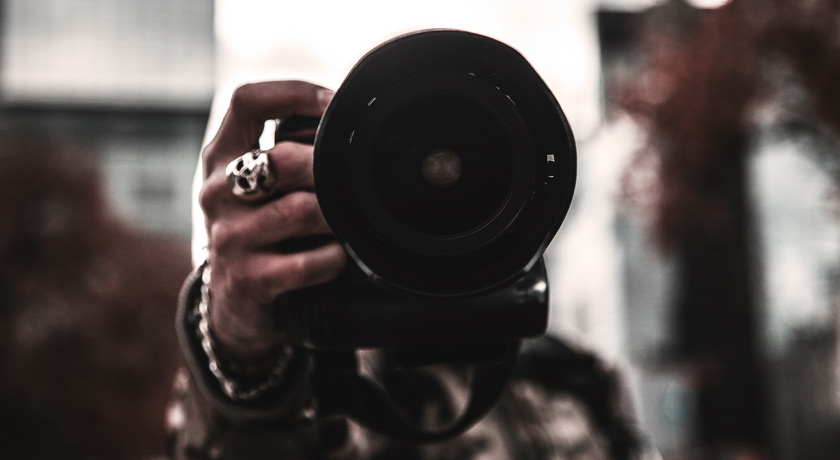 Man's hand with Camera