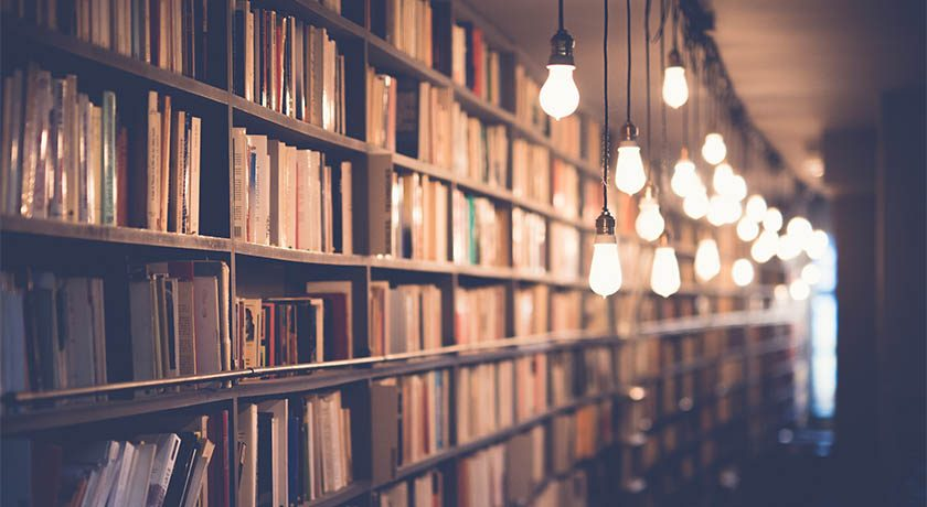 Library of books with globe lights