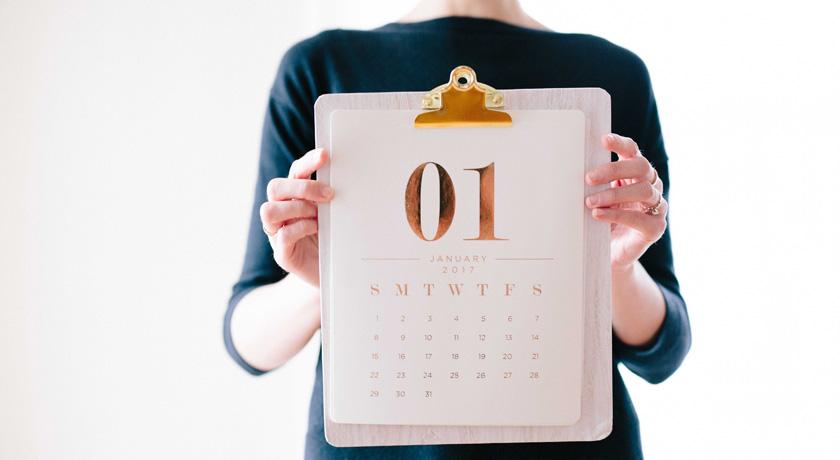 Woman holding a January Calendar