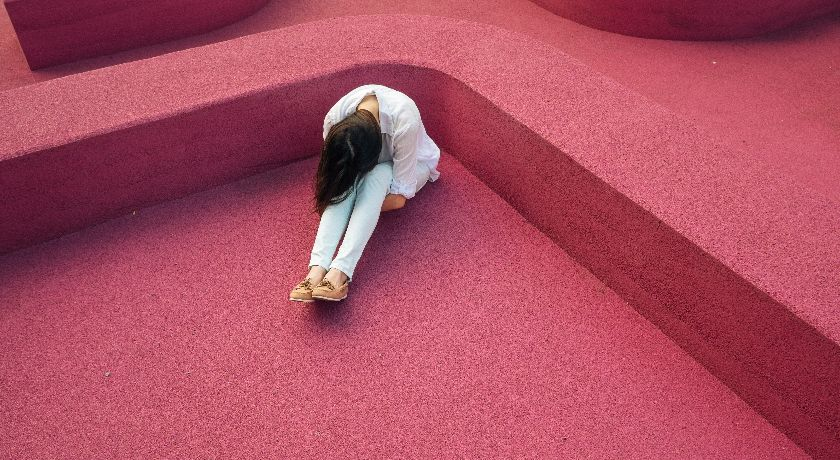 Woman with her head down, sad