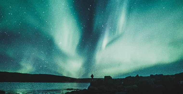 A man watching the Aurora Borealis